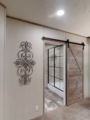 Barn Door Entry into Master Bathroom